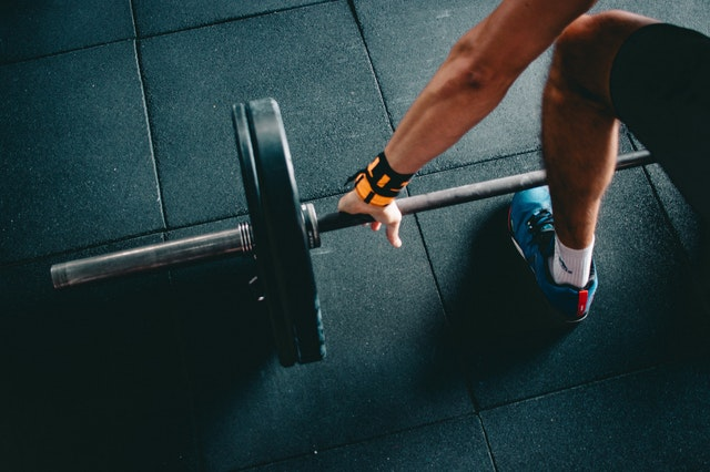 Lifting weights, a form of indoor exercise